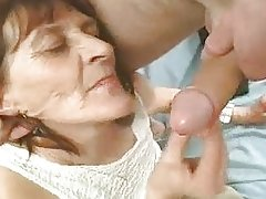 Wrinkly Granny Plays with a Cock