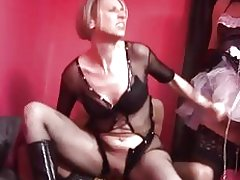 A mistress having fun with her two shemales