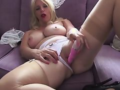 British slut Lucy G plays with herself on a purple sofa